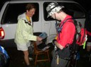 A hiker is scanned as he departs